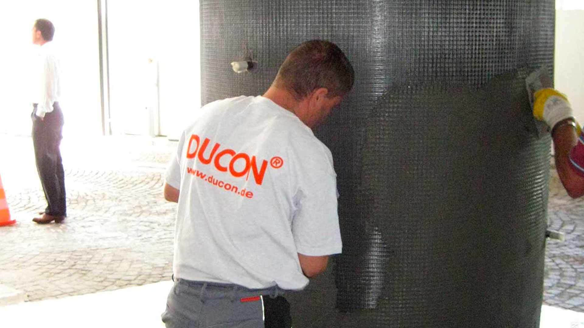 DUCON-team using troweling-infiltration technology