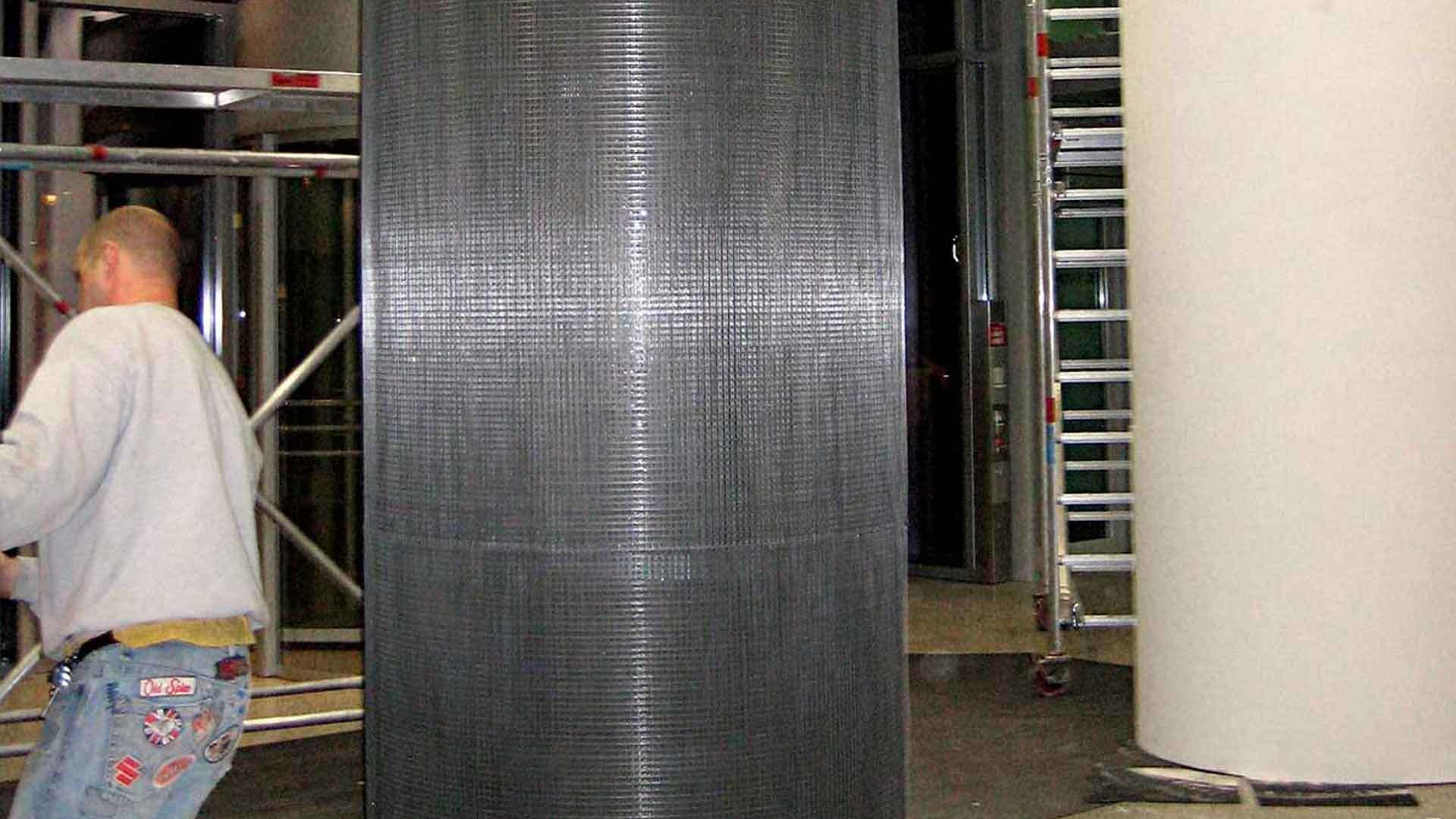 Reinforced and finished column confinement